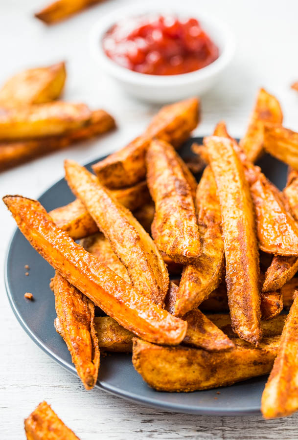 A gray plate topped with Baked Thick-Cut Seasoned Oven Fries