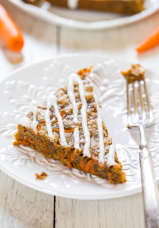 Soft Carrot Cake Bars with Cream Cheese Glaze on a white plate