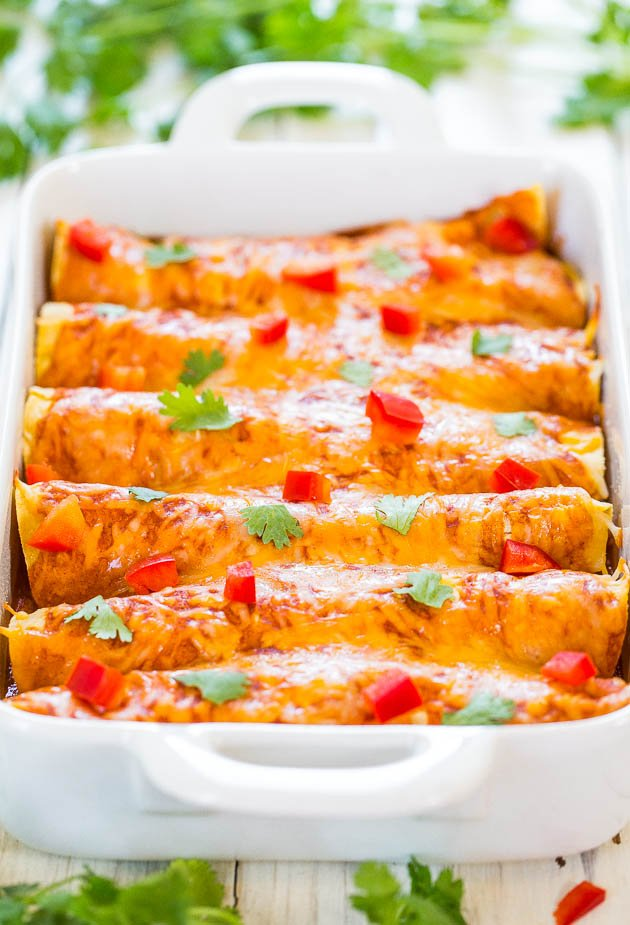 side view of sweet potato black bean enchiladas in baking dish