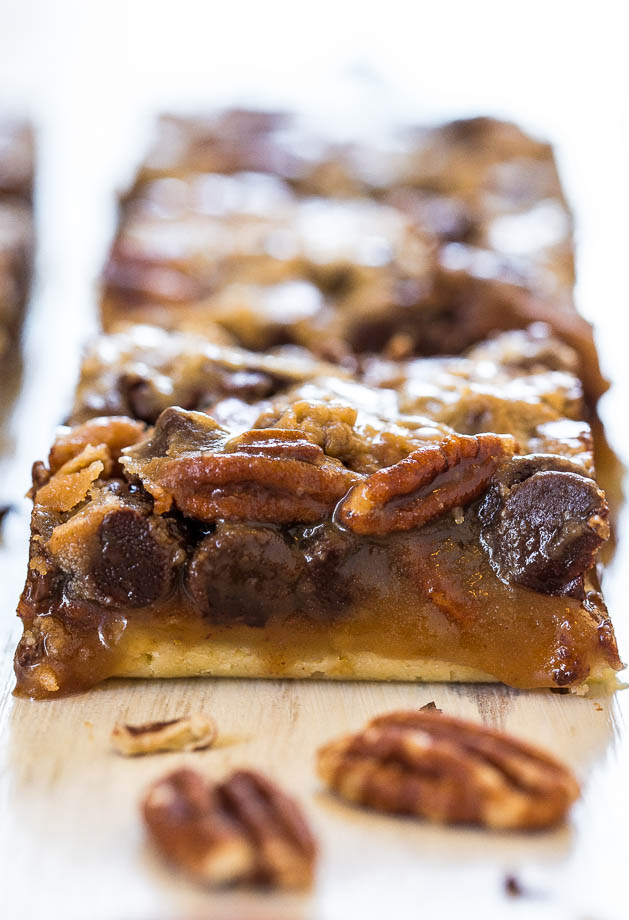 Salted Caramel and Chocolate Pecan Pie Bars - You'll never want plain pecan pie again! Caramel and chocolate makes the bars taste amazing!