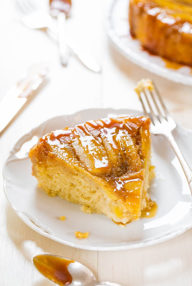 slice of Caramelized Banana Upside-Down Cake on white plate with fork