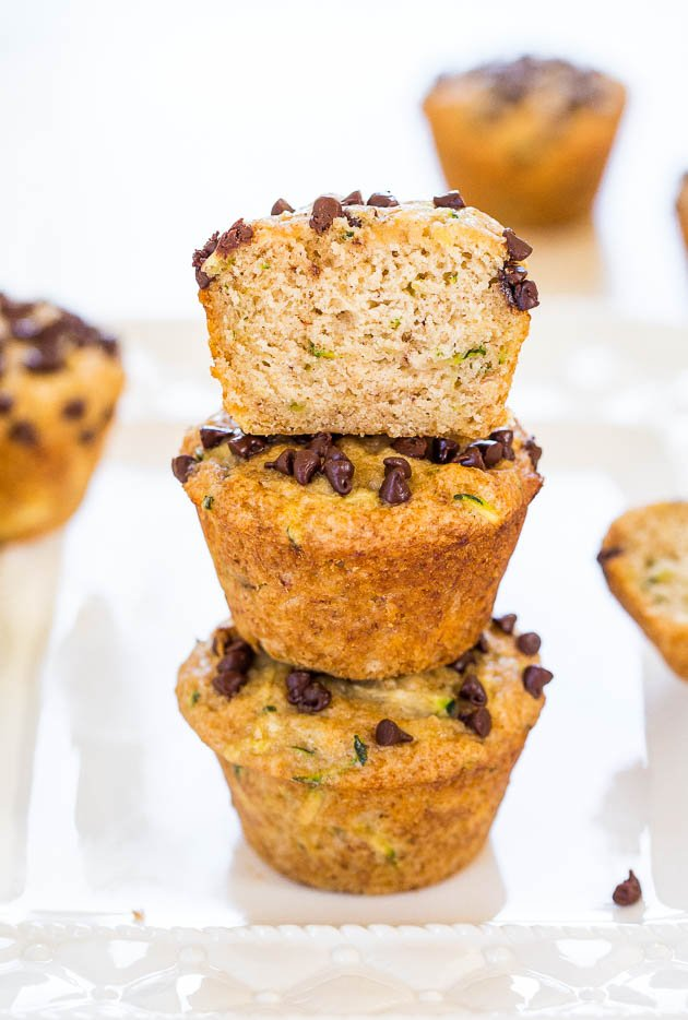 Banana Zucchini Chocolate Chip Muffins — These one-bowl, no-mixer banana zucchini chocolate chip muffins are vegan and healthy. No butter, no eggs, the chocolate chips are solely sprinkled on top, and they're made with coconut oil.