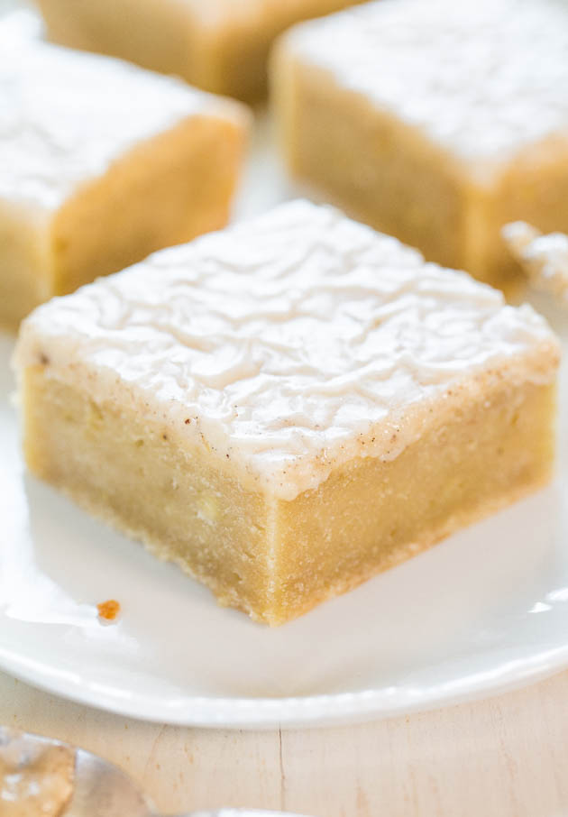 close up of Banana Bars with Vanilla Glaze on white platter