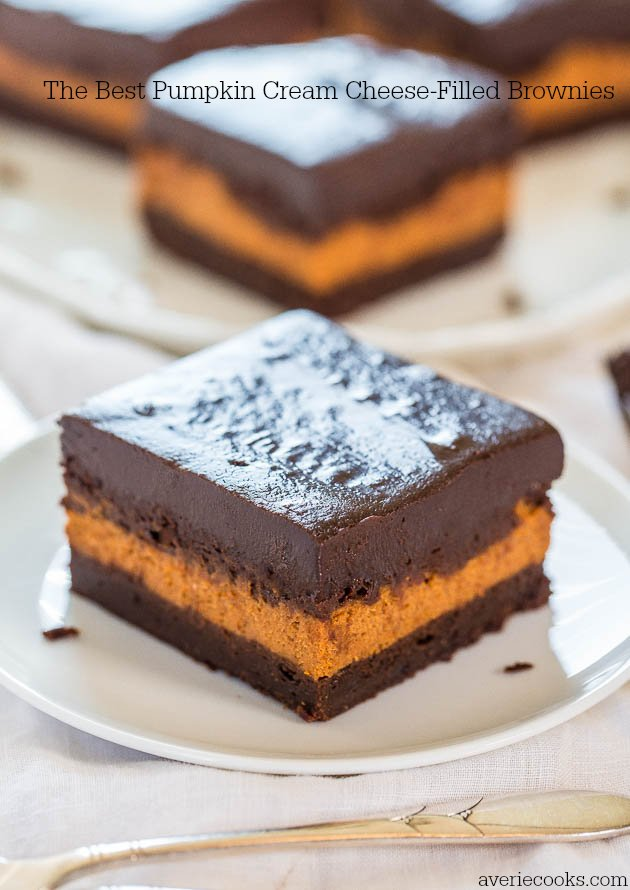 The Best Pumpkin Cream Cheese-Filled Brownies - A layer of pumpkin cheesecake inside fudgy brownies! Best pumpkin brownies ever!!