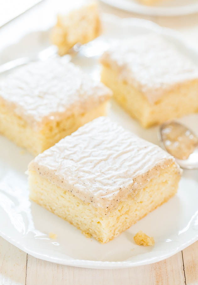 slices of Vanilla Cake From Scratch on white platter