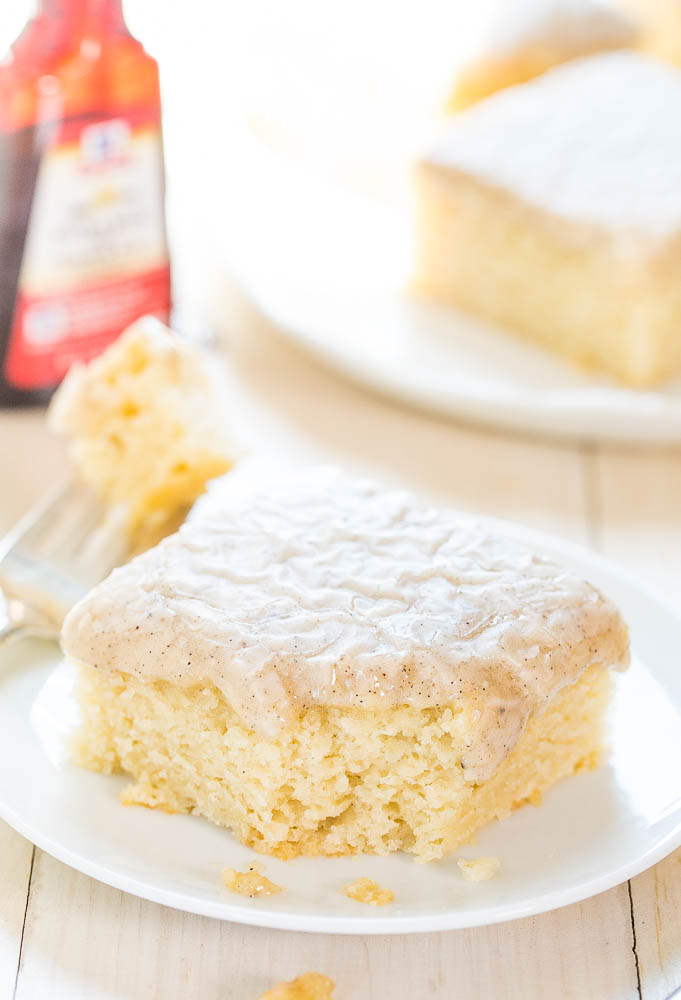 homemade vanilla cake slice on a white plate