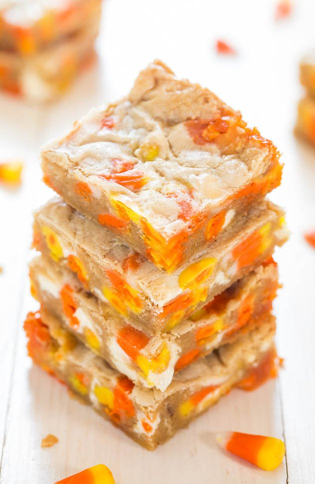 four Candy Corn White Chocolate Blondies stacked on top of each other
