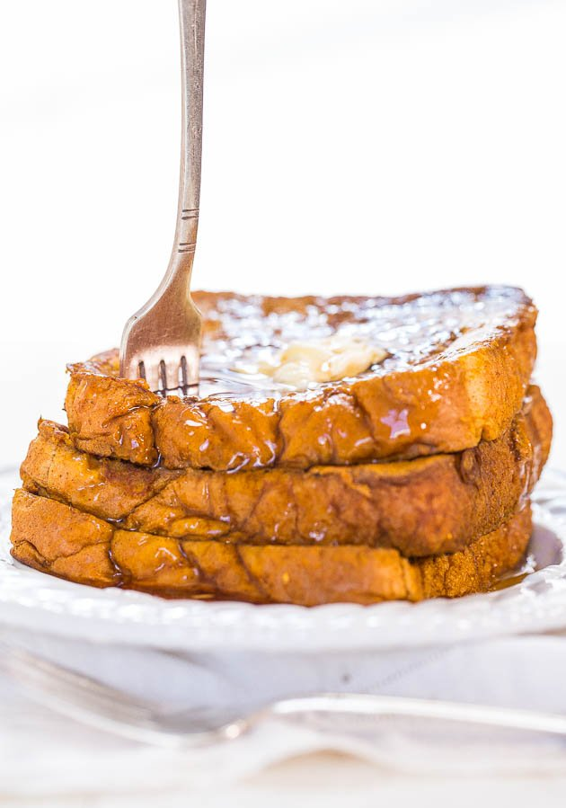 spearing a stack of Pumpkin French Toast with a fork