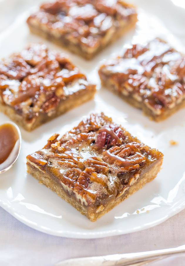 pecan bars on white platter