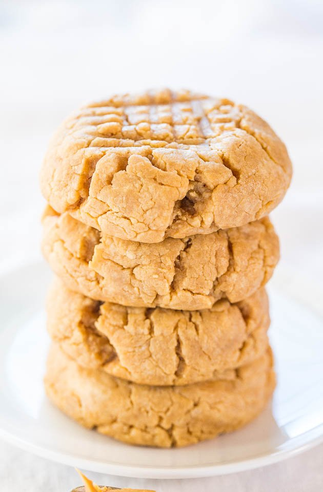 Easy 4-Ingredient Perfect Peanut Butter Cookies stacked on plate