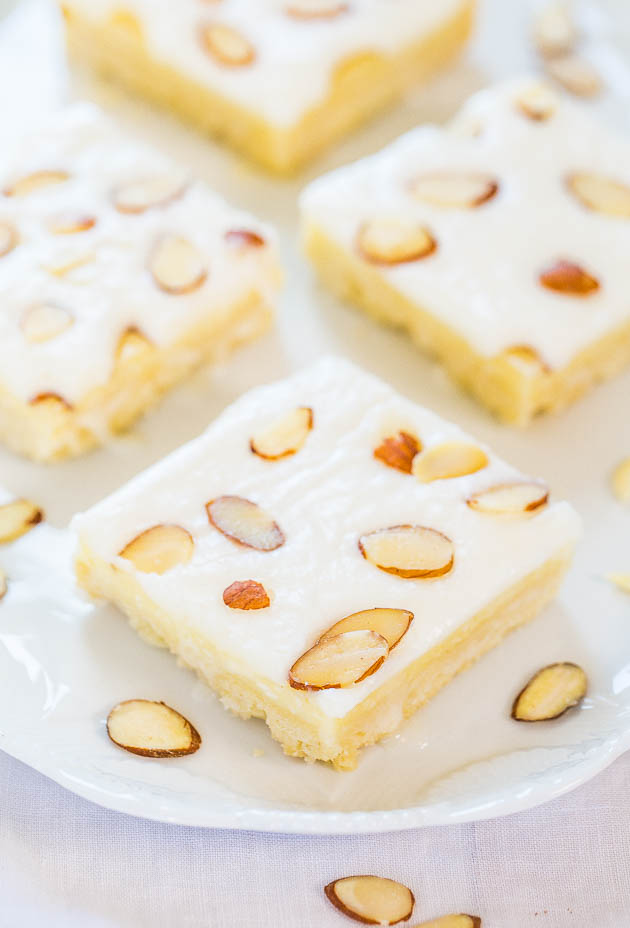 Almond Cream Cheese Bars — An easy, buttery shortbread crust is topped with cream cheese and irresistible almond frosting!! These cookie bars taste like something you'd buy at a bakery!
