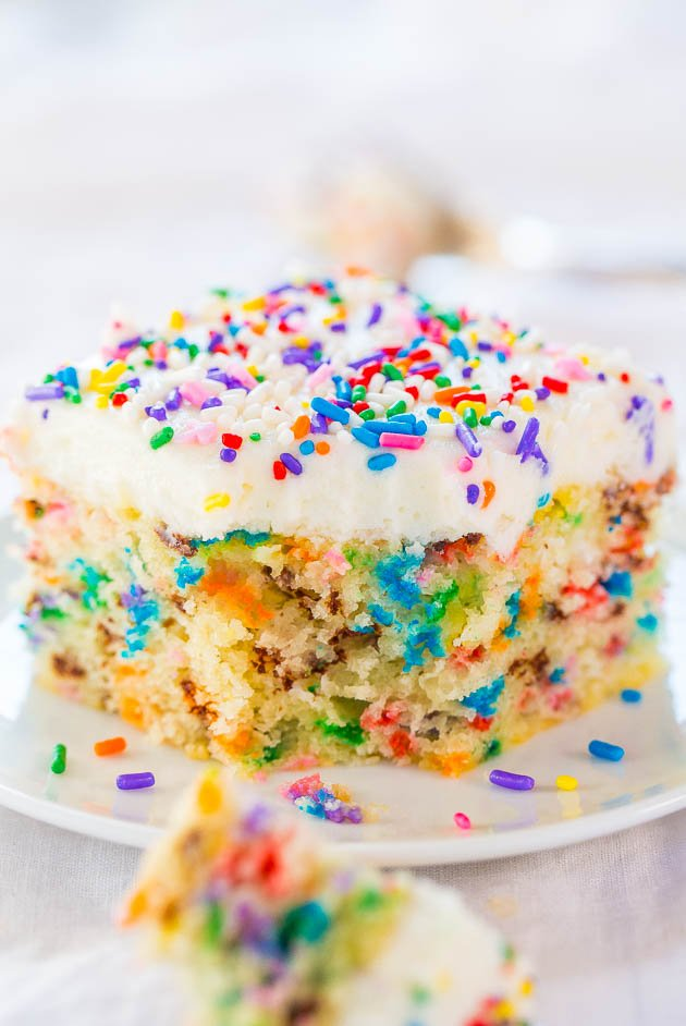 Easy Homemade Funfetti Cake with Vanilla Buttercream – Move over storebought cake mix!! This easy cake only takes minutes to make and tastes wayyyy better!! Loaded with sprinkles in EVERY bite!!