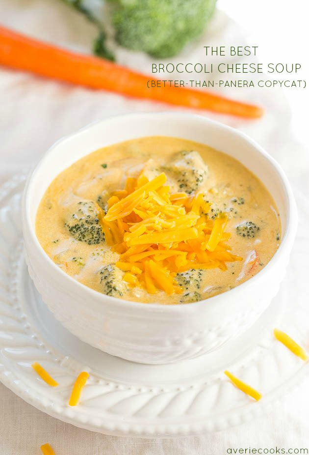 A white bowl on a white plate of Copycat Panera Broccoli Cheese Soup