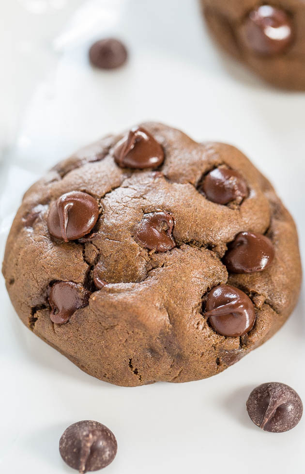 close up of a double chocolate chip cookie on white plate