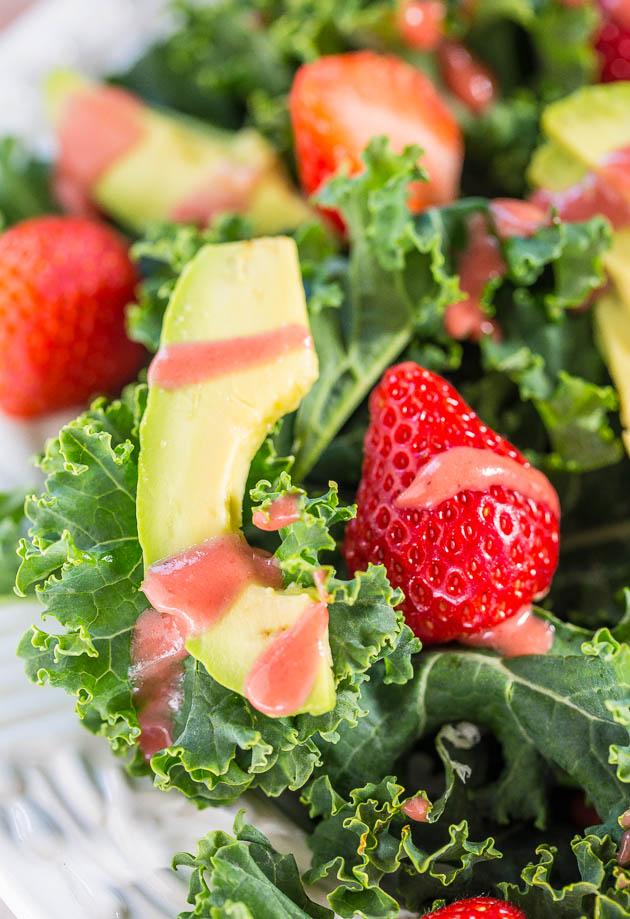 close up of strawberry kale avocado salad