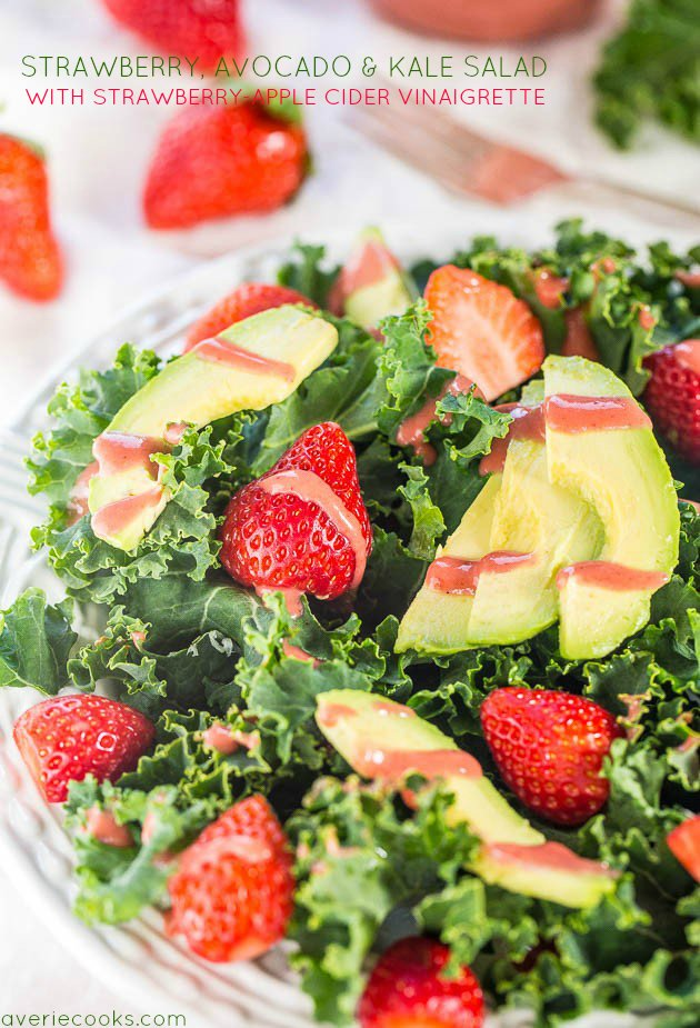 overhead view of kale strawberry avocado salad in a glass bowl