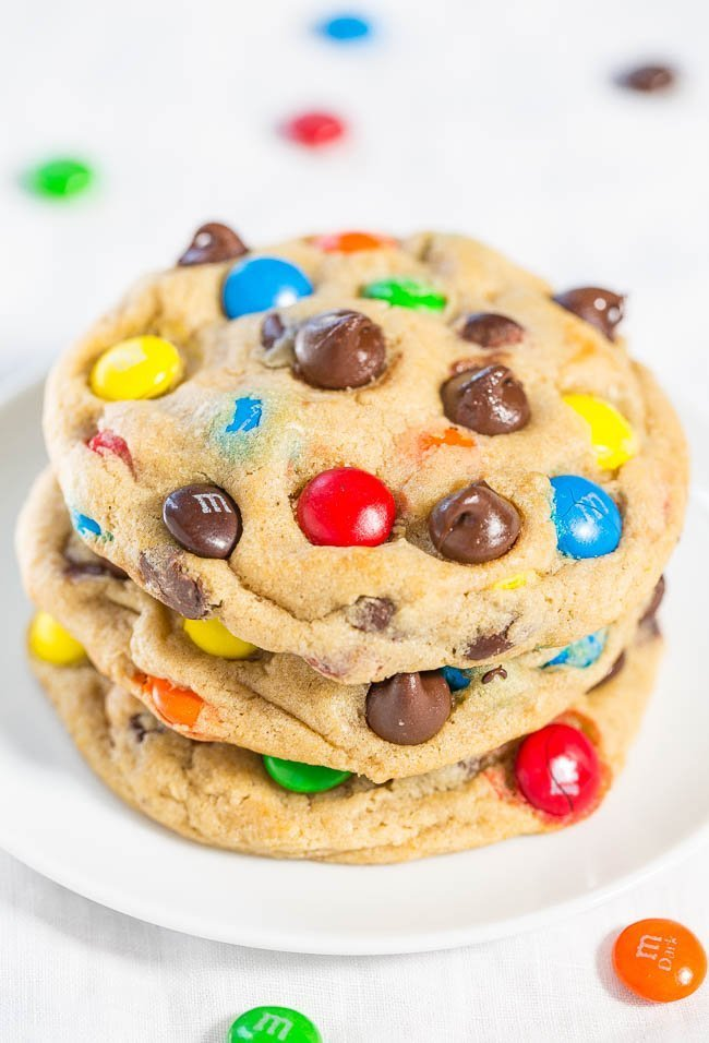 M&M cookies stacked on white plate