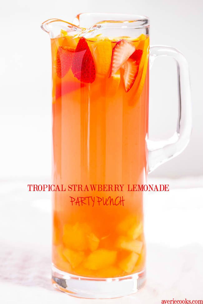 Tropical Strawberry Lemonade Party Punch - Sweet and citrusy with a tropical vibe! So fast and easy!! Punch and sangria all in one with loads of fruit!! (can be made virgin)