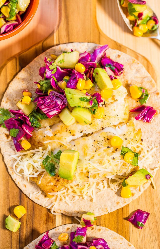 Easy 15-Minute Fish Tacos with Avocado Corn Salsa - Tons of big flavors in a fast, fresh and healthy meal!! A clean-eating recipe that tastes like comfort food!
