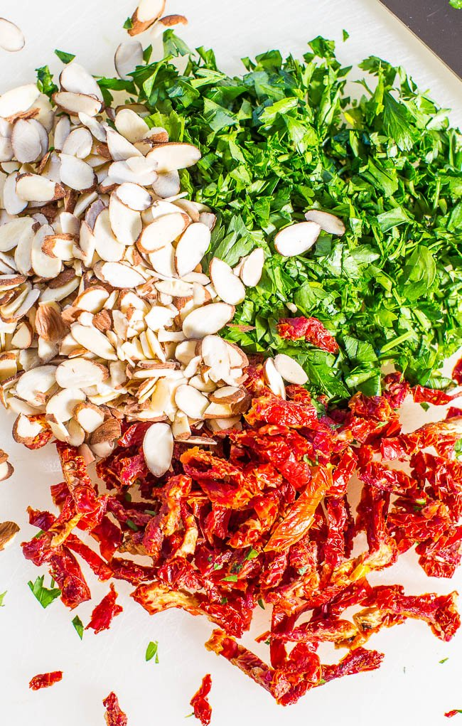 ingredients needed for zesty quinoa salad on a cutting board