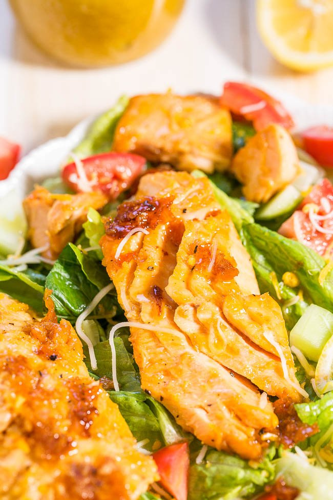 close up of salmon salad with lettuce and tomatoes