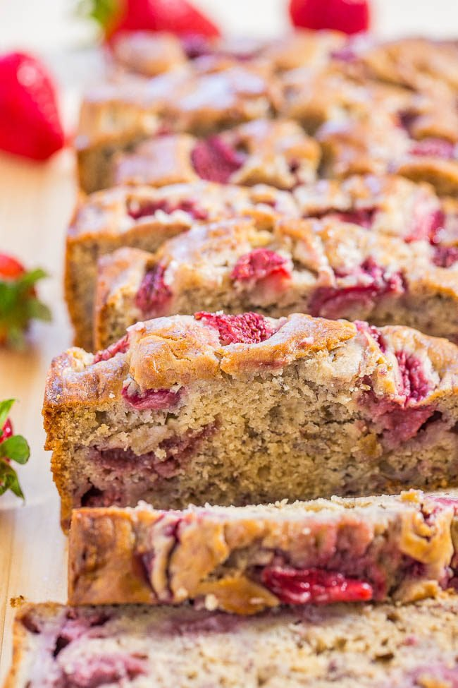 The Best Strawberry Banana Bread sliced on a wooden table