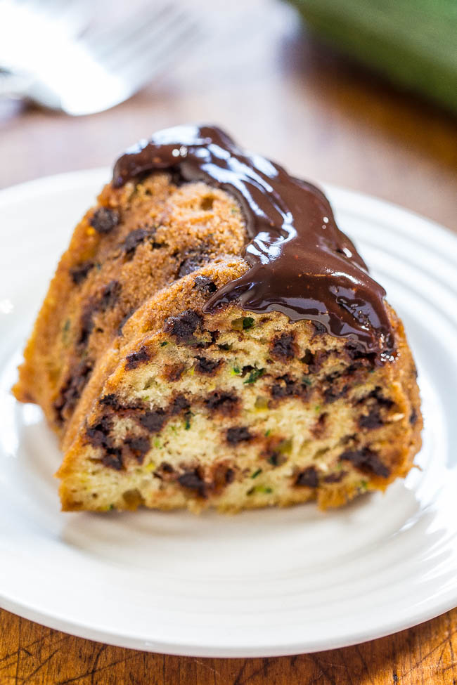 slice of chocolate chip zucchini bundt cake on white plate