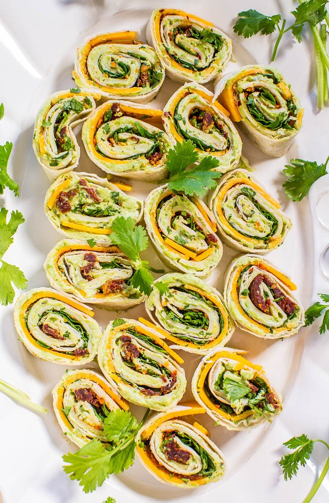 Chipotle Cheddar Avocado Tortilla Pinwheels — Creamy avocado with sharp cheddar, cilantro, and a little bit of smoky chipotle heat! Easy, ready in 5 minutes, and everyone loves these! Great appetizer and a gameday party favorite!!