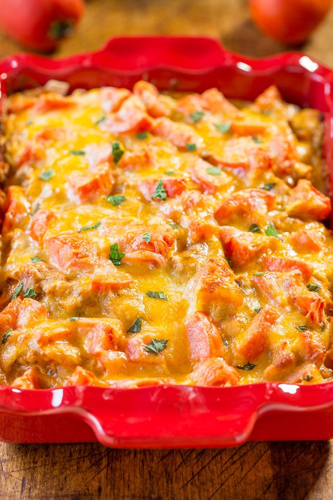Chicken Enchilada Bake in red baking dish