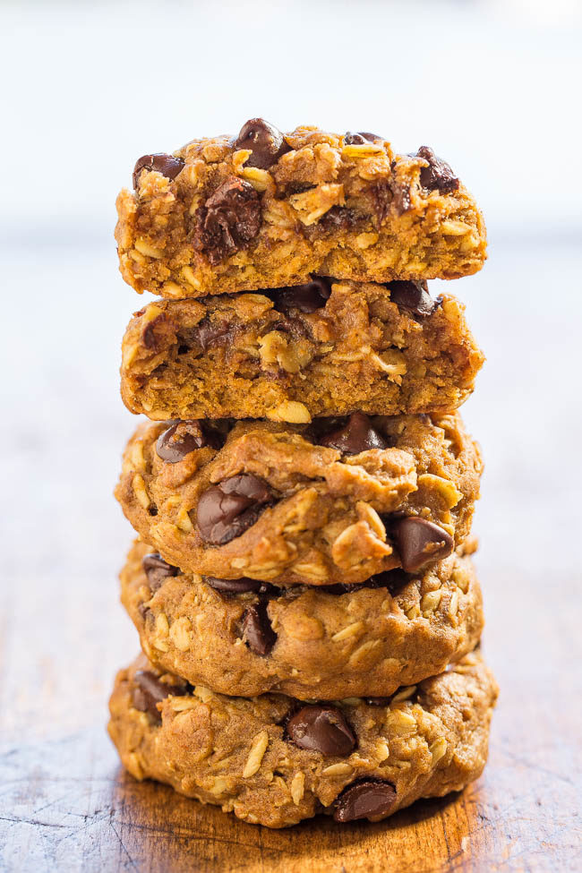 A stack of Soft and Chewy Pumpkin Oatmeal Chocolate Chip Cookies on a wooden surface