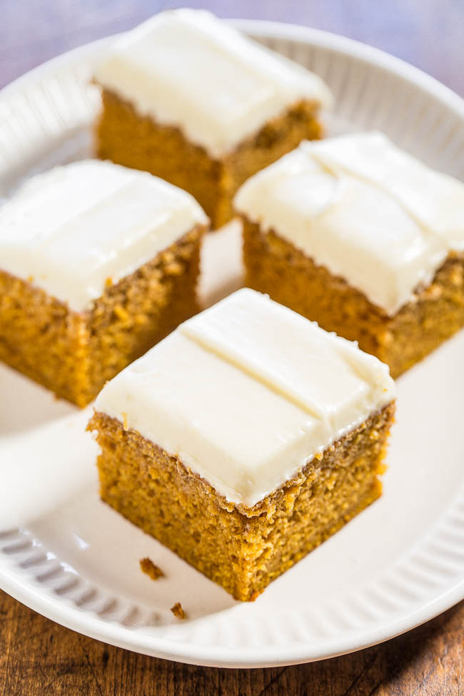 four slices of Pumpkin Cake with Cream Cheese Frosting on white plate
