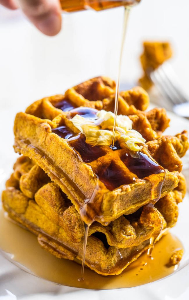 Syrup being poured on Pumpkin Waffles