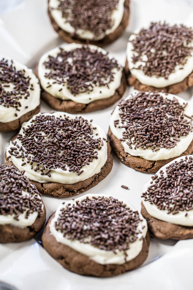 Soft Frosted Double Chocolate Cookies — Soft, chewy, double chocolate cookies topped with tangy cream cheese frosting!! A match made in heaven! And everything's better with sprinkles!!