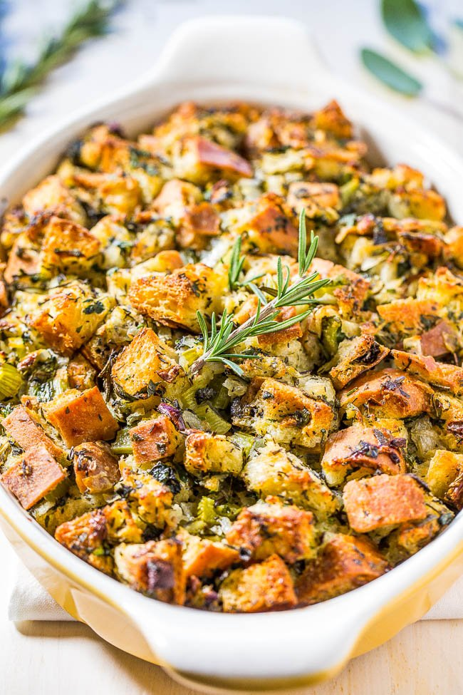 traditional Thanksgiving stuffing in a white baking dish