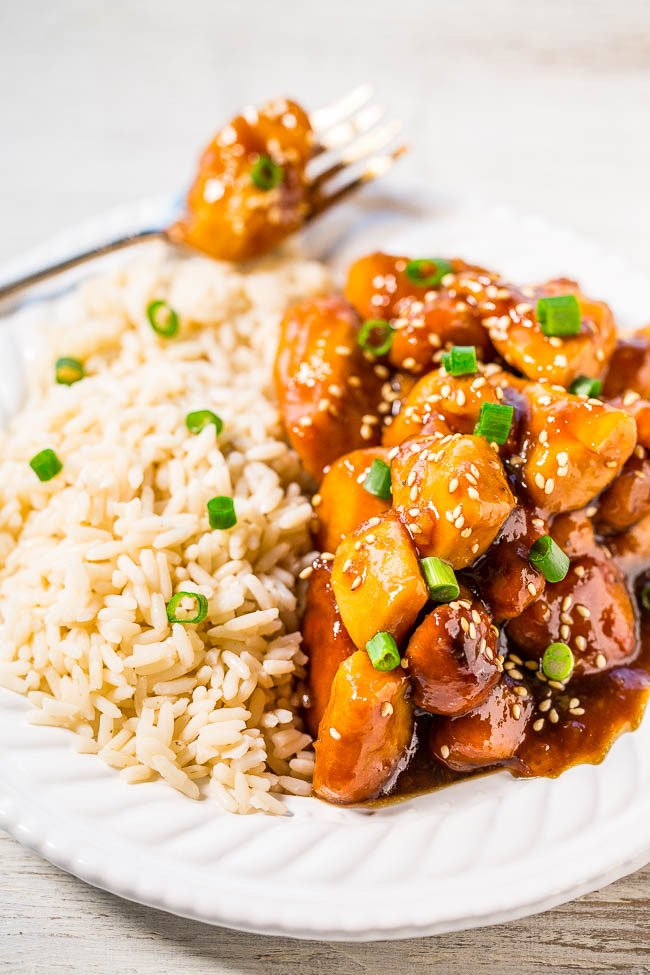 Slow Cooker Orange Chickenon a white plate with rice