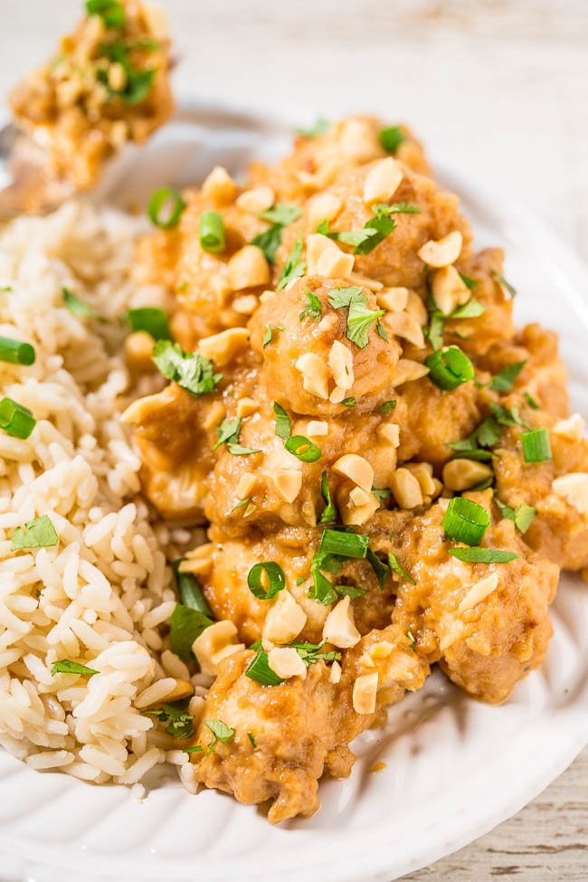 Thai Peanut Chicken with rice garnished with green onions and peanuts