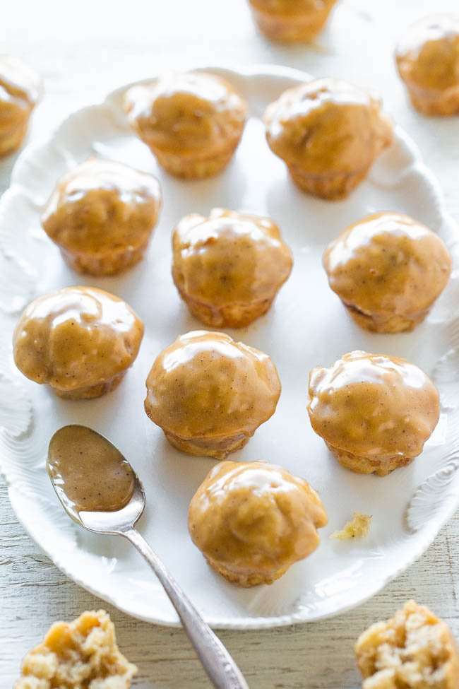 banana donut holes on white platter with spoon