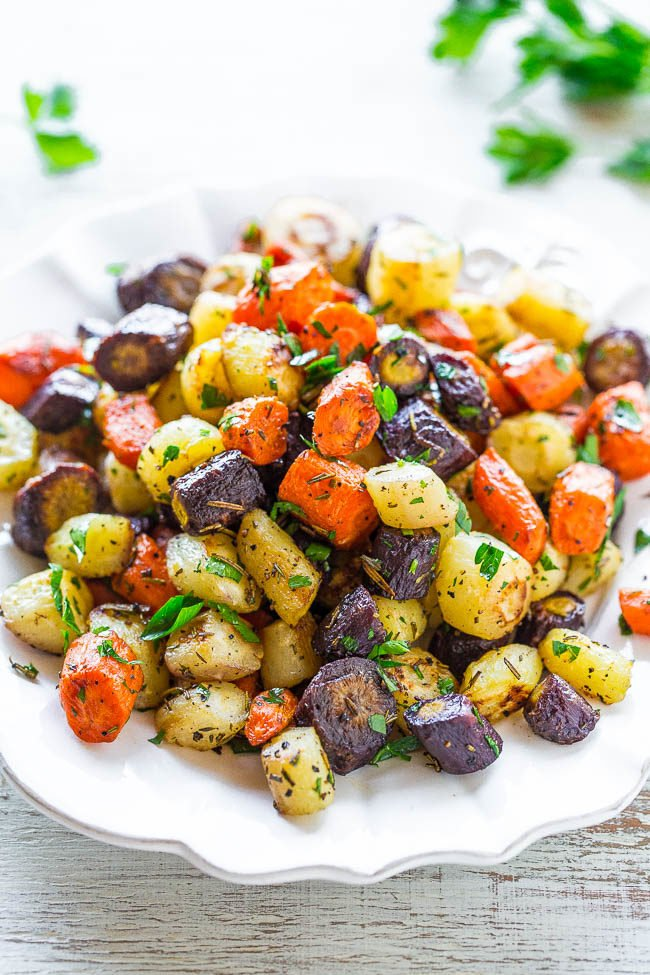 Herb-Roasted Tri-Colored Carrots - Lightly caramelized around the edges, crisp-tender in the center, and seasoned with rosemary, thyme, and parsley!! A trusty side that you'll make again and again for holidays or easy weeknight dinners!!