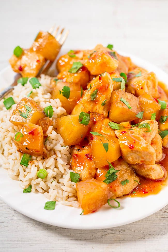 Slow Cooker Hawaiian Chicken on a white plate with rice and a fork