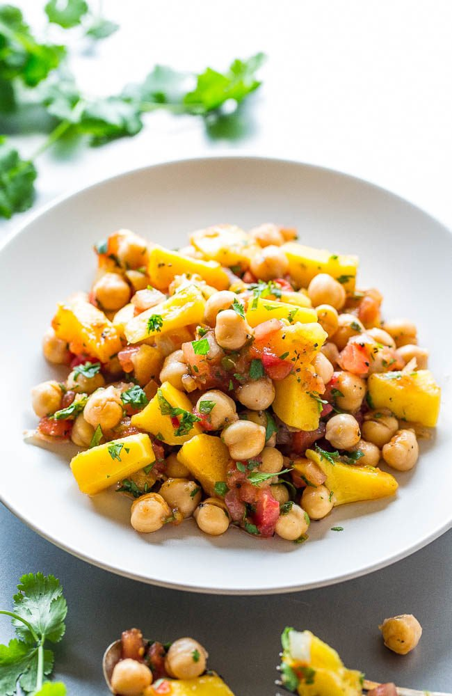 Tropical Chickpea Salad - Pineapple, mango, pineapple salsa, and pico de gallo tossed with chickpeas for a salad that tastes like a tropical vacation!! Easy, ready in 5 minutes, loaded with sweet-yet-savory flavor, and so healthy!!