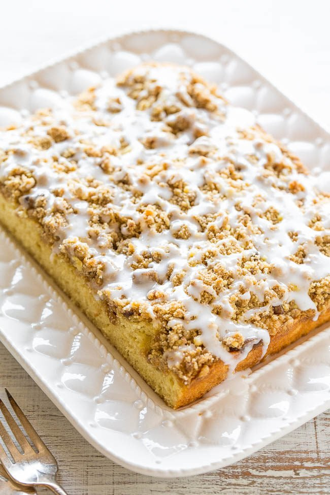 Buttery Crumb Coffee Cake - A soft, fluffy cake with cinnamon-brown sugar streusel CRUMBS and a perfectly sweet glaze!! An easy coffee cake that's perfect for brunch, holidays, or anytime you're CRAVING cake!!
