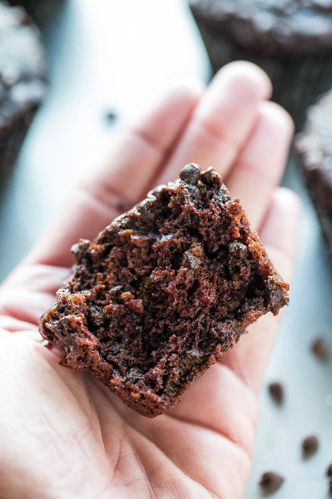 Triple Chocolate Zucchini Muffins - NO dairy or butter and only 1/4 cup oil in the entire batch!! Promise you CANNOT taste the zucchini but it keeps the muffins so soft and moist! Love sneaking in extra veggies with lots of CHOCOLATE!!
