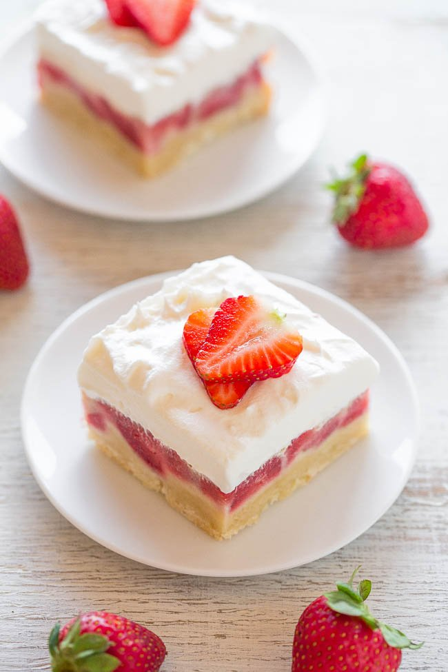 Strawberry Bars— Easy, no mixer bars with a shortbread crust, one pound of fresh berries, a layer of sweet custard, and creamy whipped topping!! A perfect warm weather dessert that everyone LOVES!!