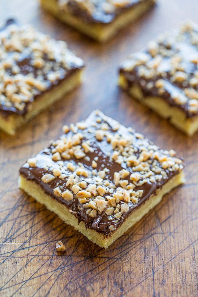 Chocolate Toffee Bars — An ultra BUTTERY base made with almond extract and topped with CHOCOLATE and TOFFEE BITS!! An easy dessert that's ready in 15 minutes but tastes like you slaved over it!!