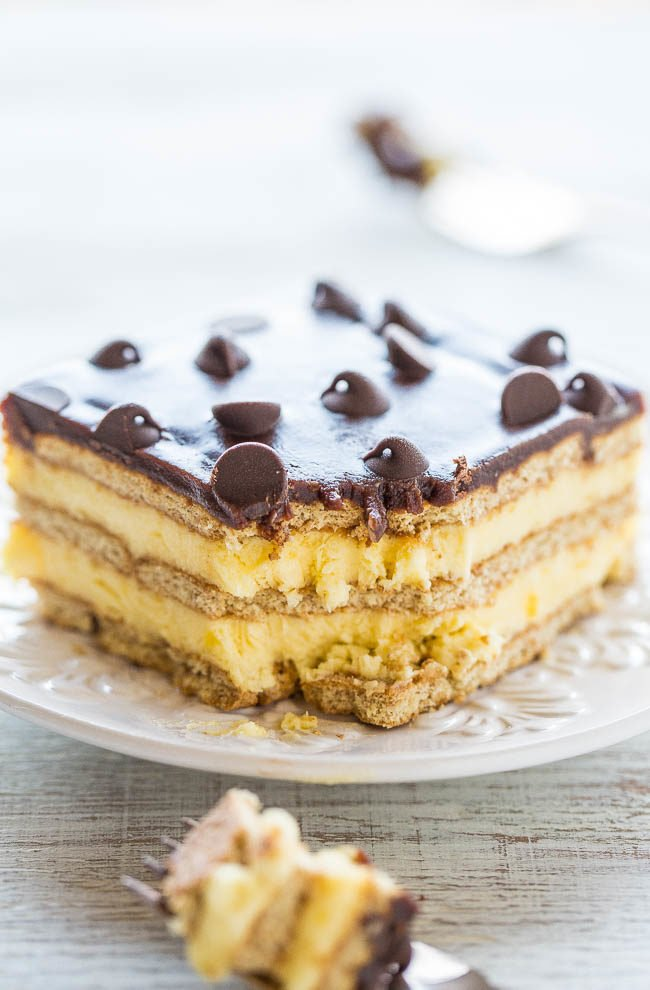 Boston Cream Icebox Cake - Boston cream PIE meets an ECLAIR in an easy no-mixer, no-bake dessert!! Vanilla pudding, whipped topping, graham crackers, and lots of chocolate! Perfect for parties or anytime you don't want to turn on your oven!!