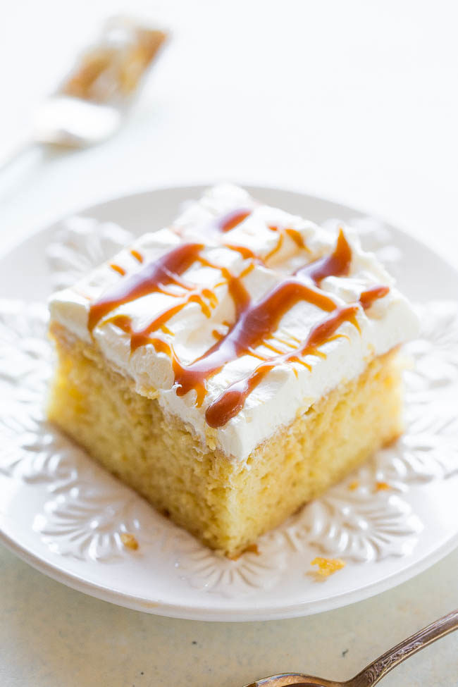 Caramel Cream Poke Cake - A creamy caramel mixture soaks into soft yellow cake before being topped with whipped cream and more CARAMEL!! An easy cake that's a guaranteed WINNER especially with caramel lovers!!