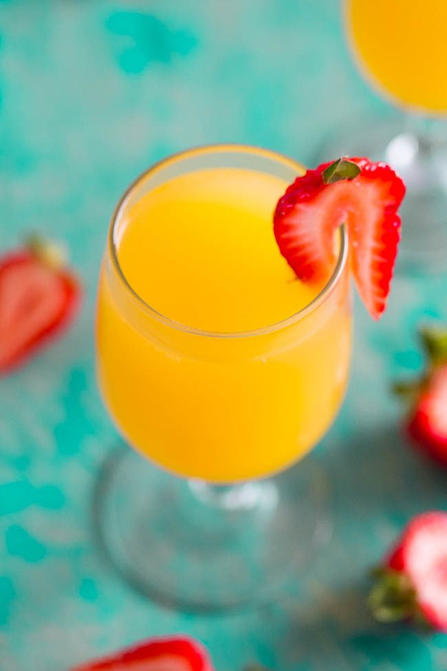 Tropical Mango Mimosas - A fun, easy, and refreshing twist on classic mimosas!! A party favorite at your next brunch or event! Everyone will want REFILLS!!