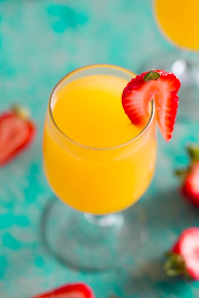 overhead view of a mimosa drink garnished with a strawberry slice
