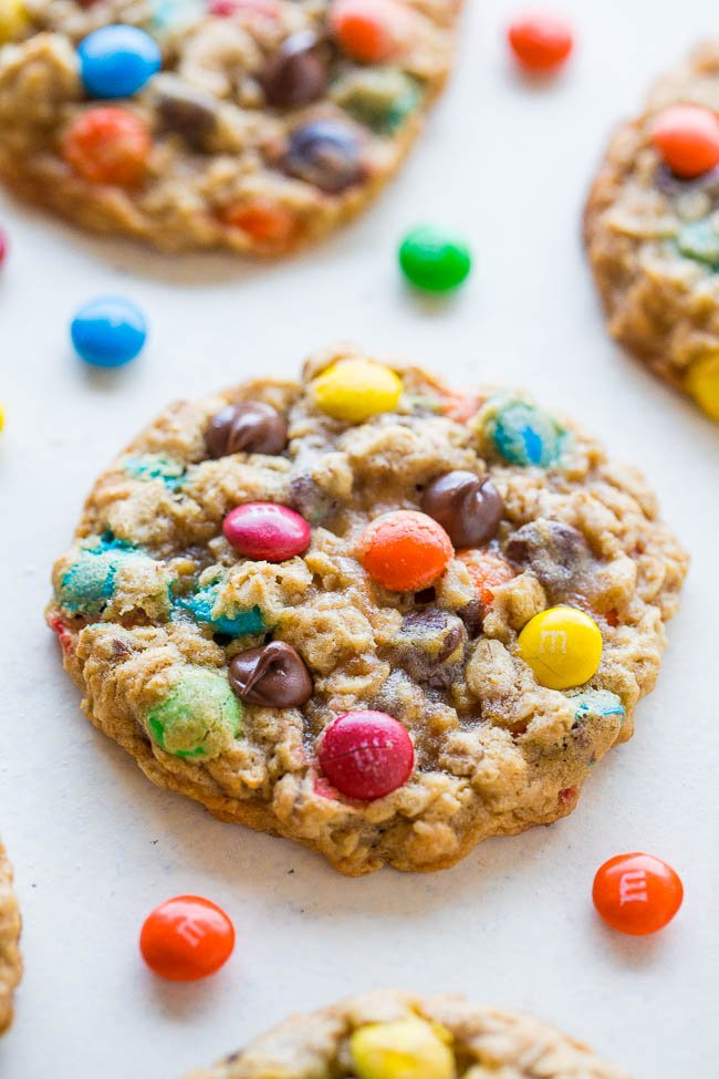 three oatmeal chocolate chip M&M cookies on countertop