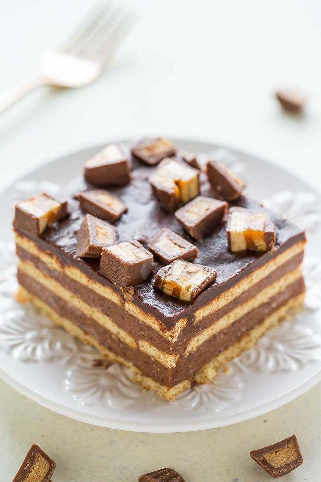 slice of candy bar cake on white plate